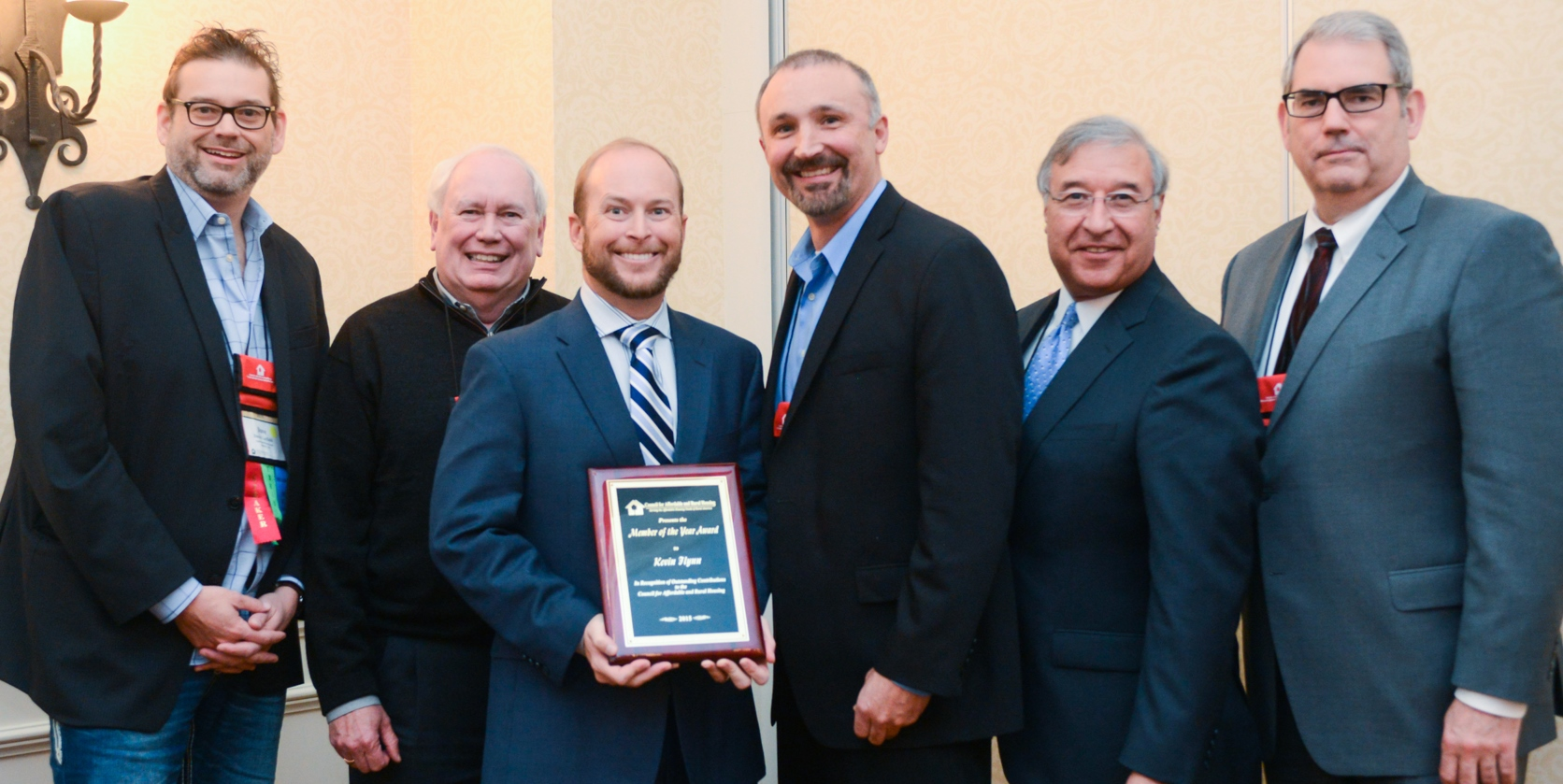 Pictured with Kevin Flynn are (from left to right) David Layfield (2015 Member of the Year), Charles Bringardner (2013 Member of the Year), Lowell Ray Barron II (Current CARH President), Tony Hernandez (Administrator, Rural Housing Service) and Don Beaty (2014 Member of the Year).